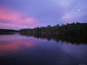 A Sunset on the Rio Negro in Brazil by Ed George
