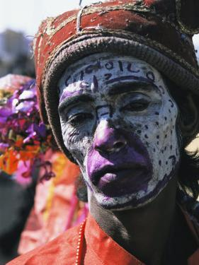 An Informal Portrait of an Indian Man with Face Paint by Ed George