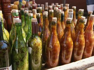 Close View of a Colorful Group of Bottles Containing Foodstuffs by Ed George