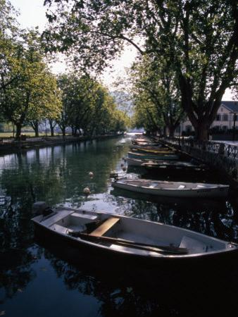 Rowboats Docked in a Tree-Lined Canal in Annecy, France