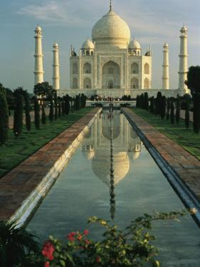 The Taj Mahal with a Reflection of the Tomb on the Surface of a Pool by Ed George