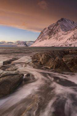 A dramatic sunset at Haukland Beach in winter, Lofoten, Nordland, Arctic by Ed Rhodes