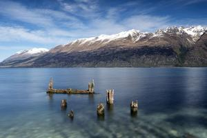Decayed jetty, old wooden posts in Lake Wakatipu at Glenorchy, New Zealand by Ed Rhodes