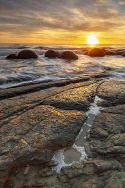 Spectacular sunrise at The Moeraki Boulders, Moeraki Beach, Otago, South Island, New Zealand by Ed Rhodes