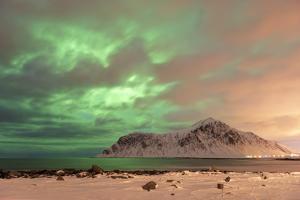The Northern Lights (Aurora borealis) with mountain range in winter, Reine, Lofoten Islands by Ed Rhodes