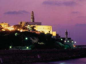 Sunset Behind Coastal Town of Jaffa, Tel Aviv, Israel by Eddie Gerald
