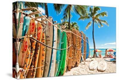 Surfboards in the Rack at Waikiki Beach - Honolulu by eddygaleotti