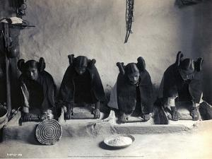 Four Young Hopi Indian Women Grinding Grain, 1906 by Edward Curtis