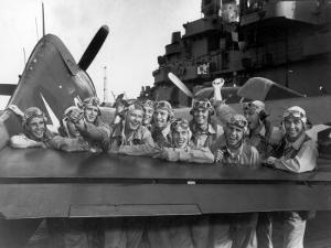 US Navy Pilots Give Grinning Group Portrait Across Tail of F-6F Hellcat on Board USS Lexington by Edward J. Steichen