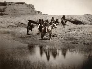 Navajo On Horseback, C1904 by Edward S. Curtis