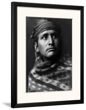 Young Brave by Edward S. Curtis