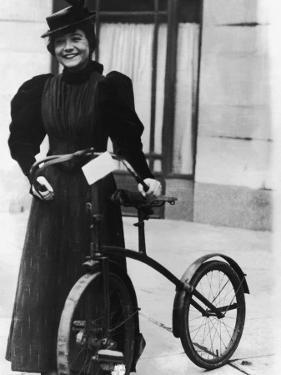 Edwardian Woman With Early Bicycle