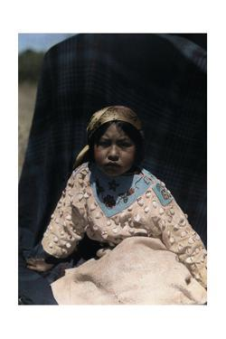 A Crow Indian Child Wears a Buckskin Dress of Beads and Teeth by Edwin L. Wisherd