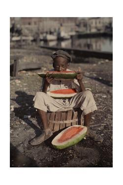 An Informal Portrait of a Young New Orleans Boy Eating Watermelon by Edwin L. Wisherd