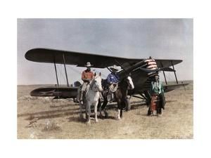 Three Men Stand in Front of a Plane on the Crow Reservation by Edwin L. Wisherd