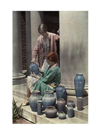 Two Newcomb Art Students Examine Some Ceramic Pots by Edwin L. Wisherd