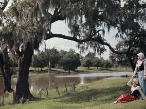 Two Women Rest Beneath a Tree, Beside the Bayou Teche Waters by Edwin L. Wisherd