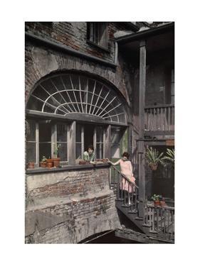 Two Women Stand by a Fan Window That Streams Sunlight into a Studio by Edwin L. Wisherd