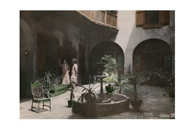 Two Women Talk in a French Quarter Courtyard by Edwin L. Wisherd