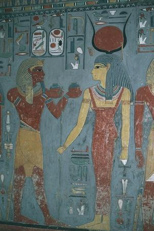 https://imgc.allpostersimages.com/img/posters/egypt-luxor-valley-of-kings-with-horemheb-between-godess-isis-and-god-horus-in-tomb-of-horemheb_u-L-PRBGDL0.jpg?p=0