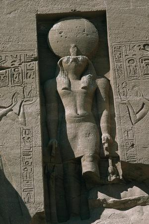 https://imgc.allpostersimages.com/img/posters/egypt-nubia-abu-simbel-great-temple-of-ramses-ii-facade-niche-with-statue-of-sun-god-ra_u-L-PRBOQU0.jpg?p=0