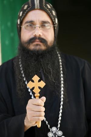 https://imgc.allpostersimages.com/img/posters/egyptian-orthodox-coptic-priest-jerusalem_u-L-Q1GYJS30.jpg?artPerspective=n