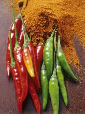Fresh Chillies and Chilli Powder on Wooden Background by Eising Studio - Food Photo and Video