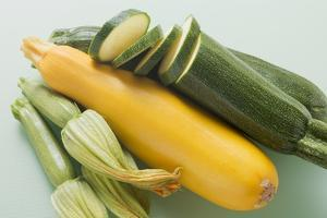 Green and Yellow Courgettes with Courgette Flowers by Eising Studio - Food Photo and Video