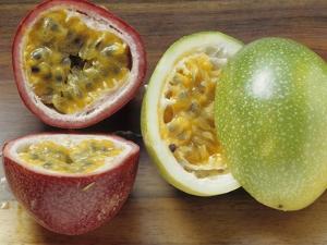 Halved Purple Granadilla and Granadilla (Passion Fruit) by Eising Studio - Food Photo and Video