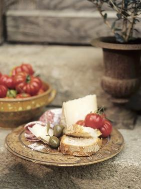 Italian Snack: Cheese, Hard Cured Sausage, Olives and Tomatoes by Eising Studio - Food Photo and Video
