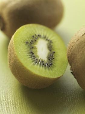 Kiwi Fruits, Whole and Halved by Eising Studio - Food Photo and Video