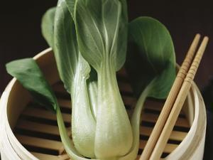 Pak Choi in Steaming Basket with Chopsticks by Eising Studio - Food Photo and Video