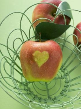 Red Apples with Heart in and Beside Wire Basket by Eising Studio - Food Photo and Video