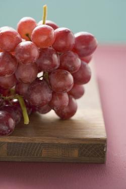 Red Grapes on Chopping Board by Eising Studio - Food Photo and Video