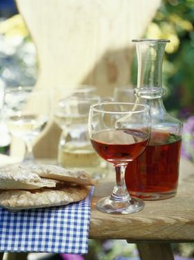 Red Wine in Glass and Carafe, Schüttelbrot Beside (S. Tyrol) by Eising Studio - Food Photo and Video