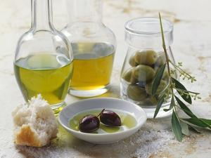 Still Life with Olives and Different Types of Olive Oil by Eising Studio - Food Photo and Video