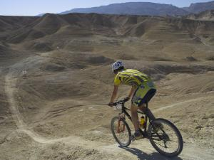 Back View of Competitior Riding Downhill in Mount Sodom International Mountain Bike Race, Israel by Eitan Simanor