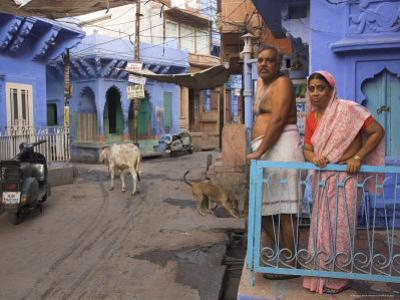 Couple Standing Outside Blue Painted Residential Haveli, Old City, Jodhpur, Rajasthan State, India by Eitan Simanor