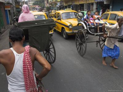 Hand Pulled Rickshaws and Yellow Taxis, Kolkata, West Bengal State, India by Eitan Simanor