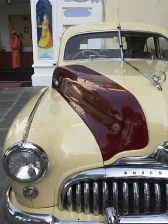Old Buick Car in Front of Entrance to the City Palace Hotel, Old City, Udaipur, India by Eitan Simanor