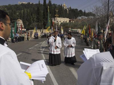Palestinian Priests Heading the Palm Sunday Catholic Procession, Mount of Olives, Jerusalem, Israel by Eitan Simanor
