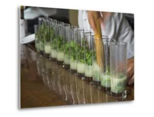 Row of Glasses on a Bar with Barman Preparing Mojito Cocktails, Habana Vieja, Havana, Cuba by Eitan Simanor