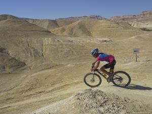 Side View of Competitior in the Mount Sodom International Mountain Bike Race, Dead Sea Area, Israel by Eitan Simanor