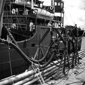 El Barco Oil Being Piped into Texaco and Socony-Vacuum Tankers