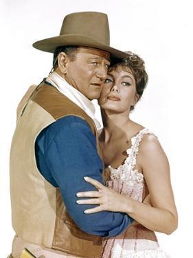 EL DORADO, 1967 directed by HOWARD HAWKS John Wayne and Charlene Holt (photo)