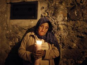 Elderly Woman Holds a Candle as She Takes Part in a Procession During Holy Week in Taxco, Mexico