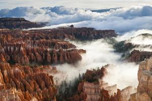 Pinnacles and Hoodoos with Fog Extending into Clouds of a Partial Temperature Inversion by Eleanor