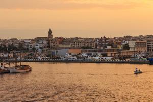 Fishing boats and town at sunrise, Palamos, Costa Brava, Girona, Catalonia, Spain, Europe by Eleanor Scriven