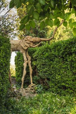 Gala Dali Castle Museum, elephant statue in garden, medieval home museum of Salvador Dali, Pubol, B by Eleanor Scriven