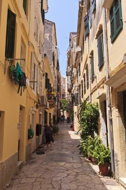 Narrow Street with Lady Sweeping, Old Town, Corfu Town by Eleanor Scriven